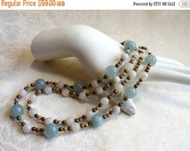 ON SALE Blue and white necklace with bronze, two strand necklace with blue fossil coral, white agate, African opal, bronze toggle and spacer