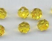 12 ultra-rare vintage Swarovski crystals - Art. 5000 - citrine AB - 10 mm