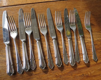 12 piece set of Dubarry pattern silver plate knives and forks