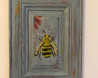 Bee on distressed wood cabinet