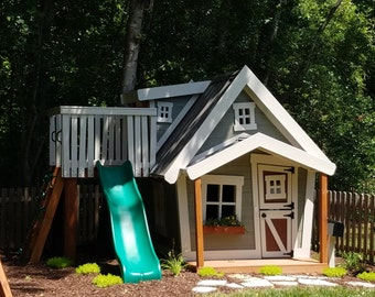 The Big Playhouse by Imagine That Playhouses!  Features dormer, slide platform with rock wall and ladder, loft, interior paint and more...