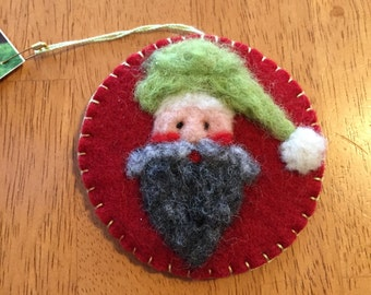 Needle Felted Santa Face With Green Hat done On Red Felt Christmas Ornament