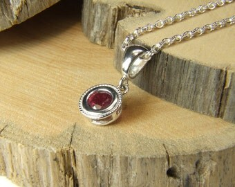 "Ruby (6.0mm Natural Ruby), 6mm x 0.80 Carat Round Cut, Sterling Silver Pendant including 18""-20"" (Adjustable) Sterling Chain"
