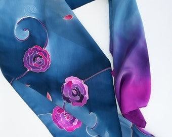 Hand painted silk scarf with floral theme. Blue, purple.