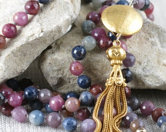 Hand knotted faceted sapphires with a vermeil tassel pendant