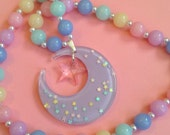 Fairy Moon - Pastel Rainbow Milky Bead Stretch Necklace with Holographic Starry Glitter Purple Crescent and Transparent Pink Star Charm