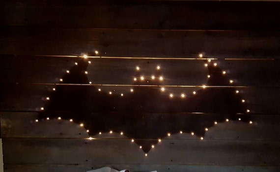 The lighted reclaimed wood customize able graphic design headboard