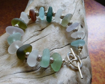 Genuine sea glass bracelet.  Beach glass.  Hand gathered.  2 pcs of lavender.  Bali silver beads.  Ocean vibe.
