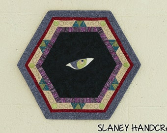 Small wall hanging quilt of an eye, spooky decoration.