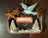Altoids Tin Mixed Media Assemblage,  hanging art. Christmas ornament, decor.  Bottle brush trees, beads peace, bird, tin stars