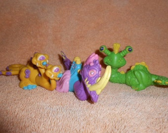Three CURRENT Dragons Sea Monsters Creatures