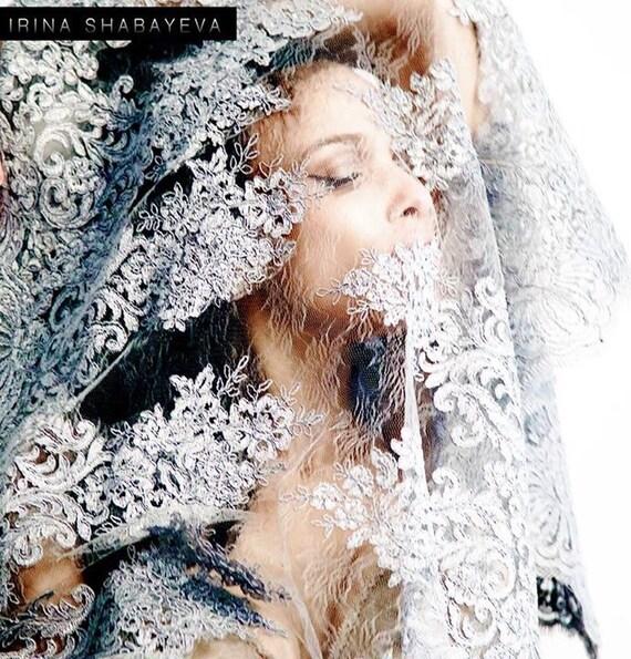 Irina Shabayeva grey lace shawl with scalloped lace edges.