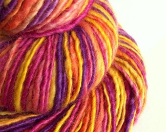Handspun knitting yarn, handpainted chunky yarn, blue faced leicester fibre, pink, purple and golden yellow wool
