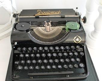 Black retro portable typewriter with original case Olympia Diplomat 4