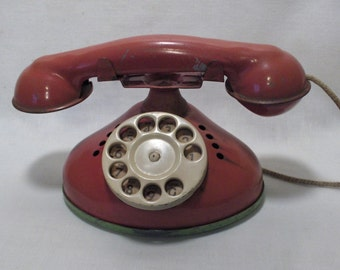 1950's Red metal Telephone childs Toy. Dial rings
