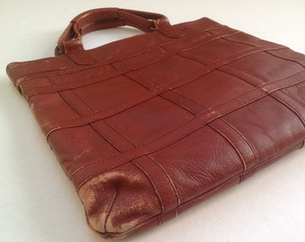 Leather satchel / 1970s retro leather purse / distressed leather handbag / top handles zipper closure / rust leather made in Columbia /