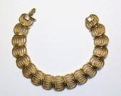 """Vintage Napier golden bracelet. Circa 1980's. Excellent condition. About 7 1/2"""" long."""