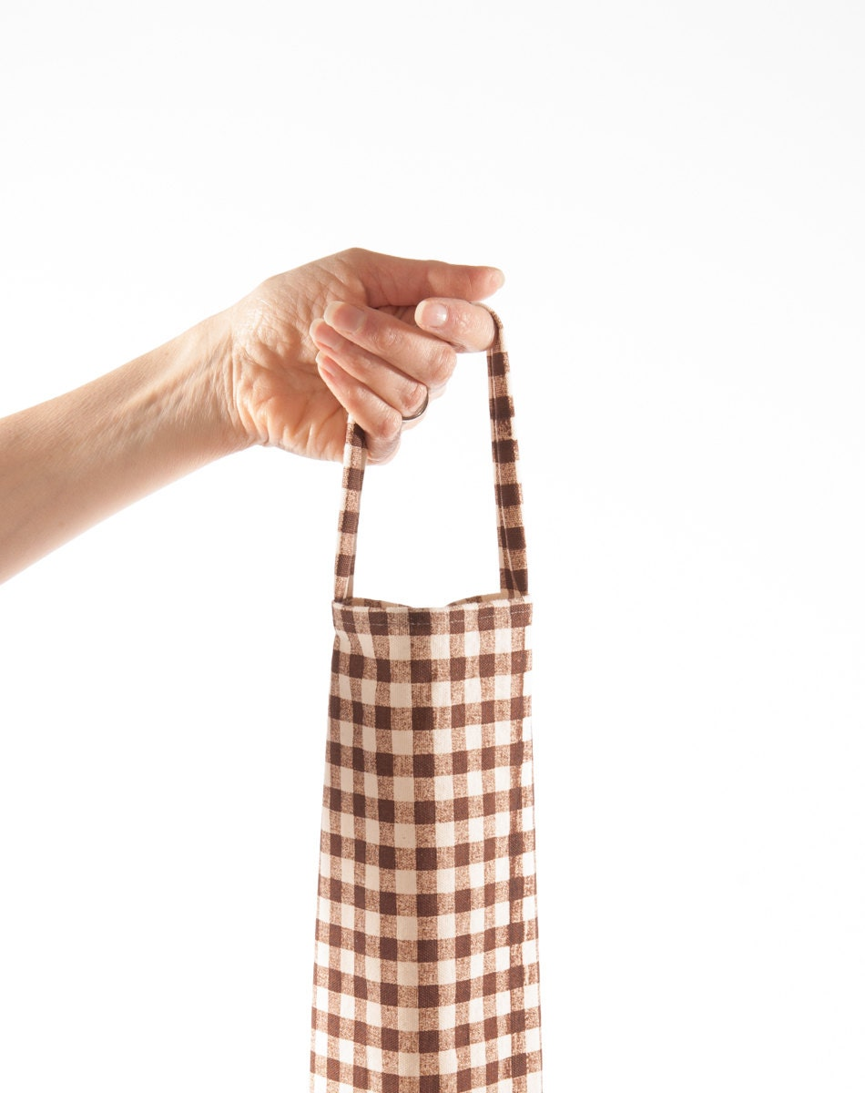 Checkered grocery bag holder plastic dispenser brown