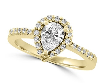 Pear-cut halo engagement ring 14k gold 0.19ct diamonds and 7x5 white sapphire