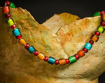 Necklace with beads in roll form and Red Bobby beads