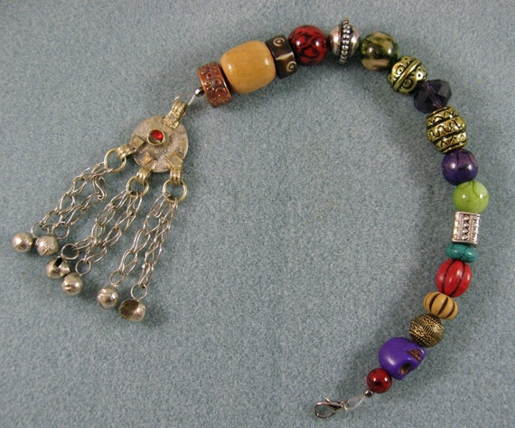 pirate style beaded ponytail holder or clip with tasseled
