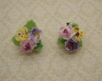 A fine period pair of floral china clip on vintage jewelry earrings of flowers hand made and painted using English bone china / porcelain
