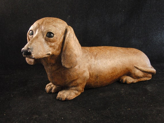 Vintage doxin dog figurine by Sandicast product