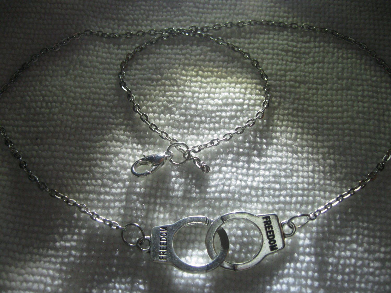 freedom nancy grace handcuffs necklace