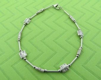 stainless steel and pewter anklet. avail in 9.5 and 10.5 inches