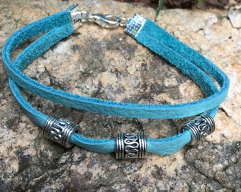 Turquoise leather bracelet with silver tone beads
