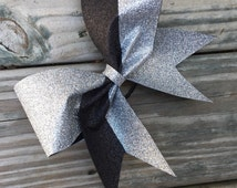 Glitter cheer bow/softball bow made with silver glitter and black glitter. Available in any color combination.