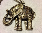 Gold metal elephant with pave set rhinestones pendant necklace.