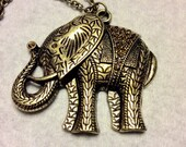 Gold metal elephant with pave set rhinestones pendant necklace.
