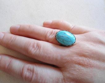 Dyed howlite traditional turquoise colored cabochon antique brass nickel free adjustable size 7 to 7.5 ring