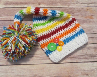 Crochet RAINBOW Pixie Hat, Jumbo Pompom, vibrant stripes, buttons, photo props, baby shower gift, baby boy, baby girl, preemie to 12 months