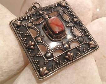 Tribal RED Ammolite and sterling silver pendant