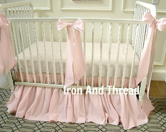Crib Bedding. Bumperless Light Pink Crib Skirt with 3 Large Bows.