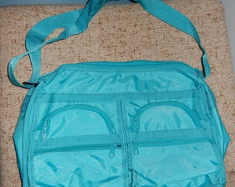 Vintage Bright Turquoise Nylon Messenger Bag from the 1980s
