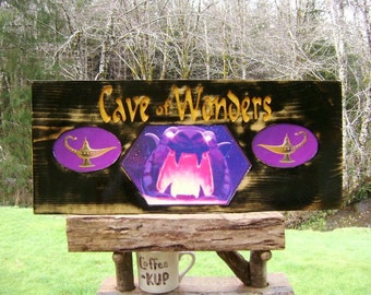 Children's Disney movie fantasy sign, CAVE OF WONDERS hand-cut lettering distressed Pine with a decoupage of Aladdin's cave and genie lamps