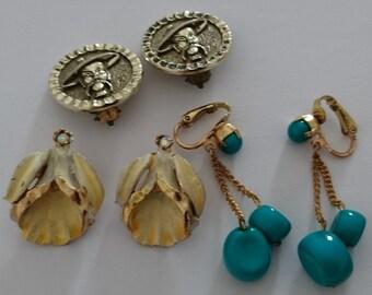 Three interesting pairs of vintage clip on earrings