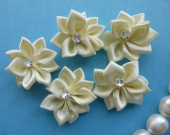 Ivory satin flower with rhinestone.   Satin ribbon flower.   Approximately  26mmx28mm across.  Set of 9
