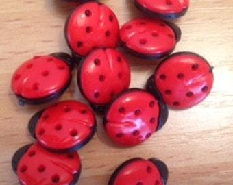 Ten ladybird 16mm shank plastic buttons