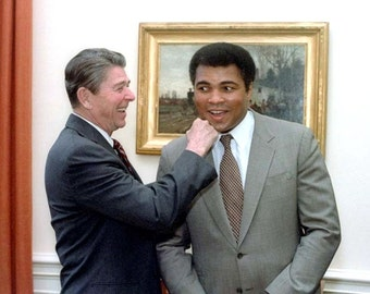 Muhammad Ali , President Ronald Reagan with Ali in the Oval Office in 1983