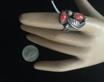a ladies ring in silver and coral,southwestern,circa 1970