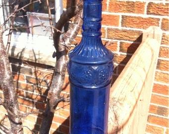 1 Cobalt Blue Glass Bottle. Collectible Decorative Cobalt Blue Glass Bottle.