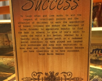 Success Poem by Ralph Waldo Emerson on a block of wood