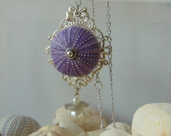 A purple Sea Urchin Necklace.