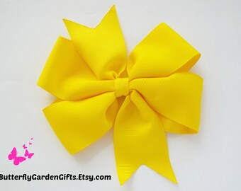 Yellow pinwheel hair bow clip