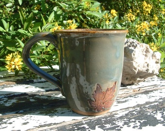 Handmade stoneware leaf mug in green