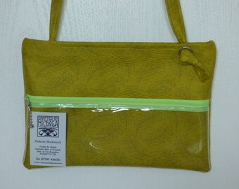 Slim line pouch handbag, cross body, or shoulder bag. Lime green feather print.